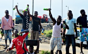 Photo: Lagos area boys celebrate Democracy Day with beer from ill-fated lorry
